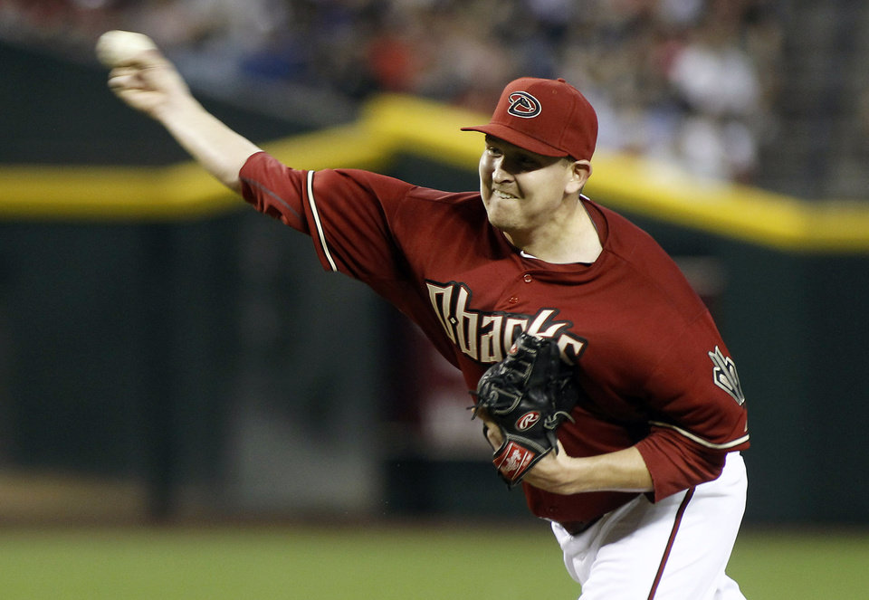 Photo - Arizona Diamondbacks' Trevor Cahill delivers a pitch against the Los Angeles Dodgers during the first inning of a baseball game on Sunday, April 13, 2014, in Phoenix. (AP Photo/Ralph Freso)