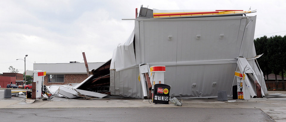Photo - The awning of a gas station is destroyed near downtown Cullman, Ala., Wednesday, April, 17, 2011.  An apparent tornado hit the area about 3 p.m.  A wave of thunderstorms with near hurricane-force winds pushed across Alabama on Wednesday, killing at least five people including a woman in a mobile home and sending snapped tree limbs onto cars and homes.  (AP Photo/The Birmingham News, Mark Almond)