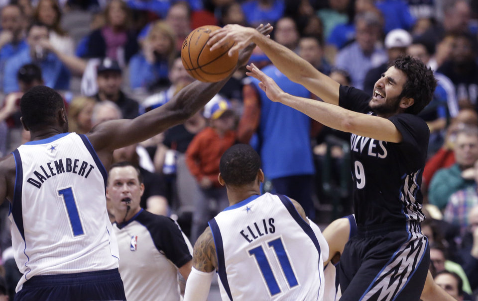 Photo - Minnesota Timberwolves guard Ricky Rubio (9) of Spain is fouled by Dallas Mavericks center Samuel Dalembert (1) as  Monta Ellis (11) looks on during the first half an NBA basketball game Wednesday, March 19, 2014, in Dallas. (AP Photo/LM Otero)