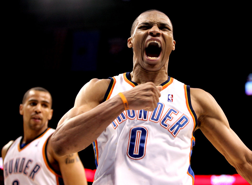 Photo - CELEBRATION: Oklahoma City's Russell Westbrook (0) celebrates during the NBA basketball game between the Oklahoma City Thunder and the Utah Jazz, Sunday, March 15, 2010, at the Ford Center in Oklahoma City. Photo by Sarah Phipps, The Oklahoman  ORG XMIT: KOD