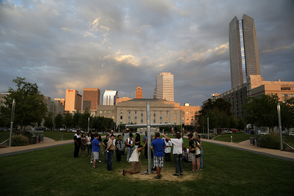 Photo - A Christian group gathers in protest of a Black Mass at the Civic Center Music Hall, Sunday, Sept. 21, 2014.  Photo by Garett Fisbeck, For The Oklahoman