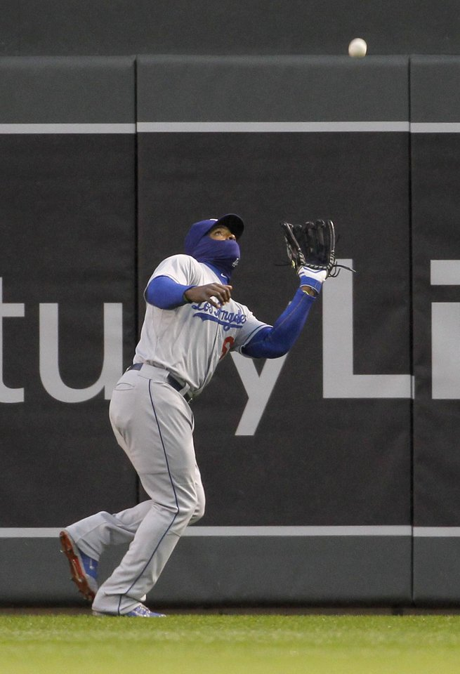Photo - Los Angeles Dodgers right fielder Yasiel Puig catches a fly ball to right field by Minnesota Twins' Brian Dozier during the first inning of a baseball game in Minneapolis, Wednesday, April 30, 2014. (AP Photo/Ann Heisenfelt)