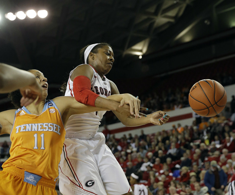 Photo - Georgia guard Sydnei McCaskill, right, and Tennessee forward Cierra Burdick (11) battle for a rebound in the first half of an NCAA college basketball game Sunday, Jan. 5, 2014, in Athens, Ga. (AP Photo/John Bazemore)
