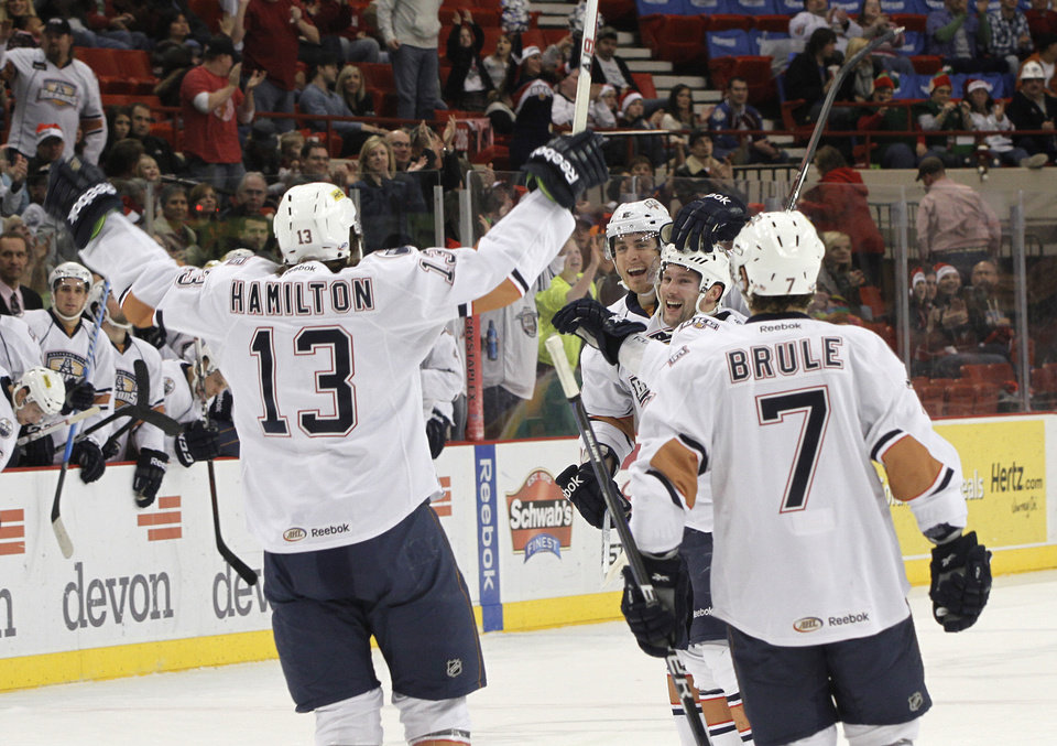 AHL HOCKEY: OKC's Curtis Hamilton (13) celebrates with his teammates after a goal during a game between the Oklahoma City Barons and the Houston Aeros at the Cox Convention Center in Oklahoma City, Saturday, Dec. 17, 2011.  Photo by Garett Fisbeck, The Oklahoman ORG XMIT: KOD
