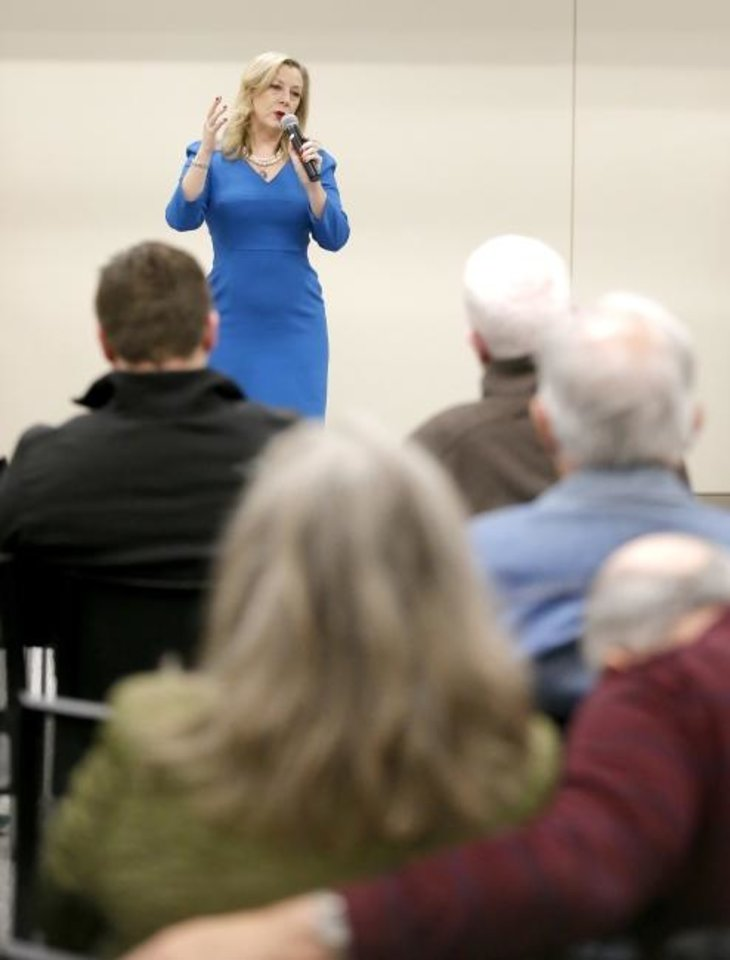 Photo -  U.S. Rep. Kendra Horn speaks Saturday at a town hall meeting in Bethany.  [Sarah Phipps/The Oklahoman]