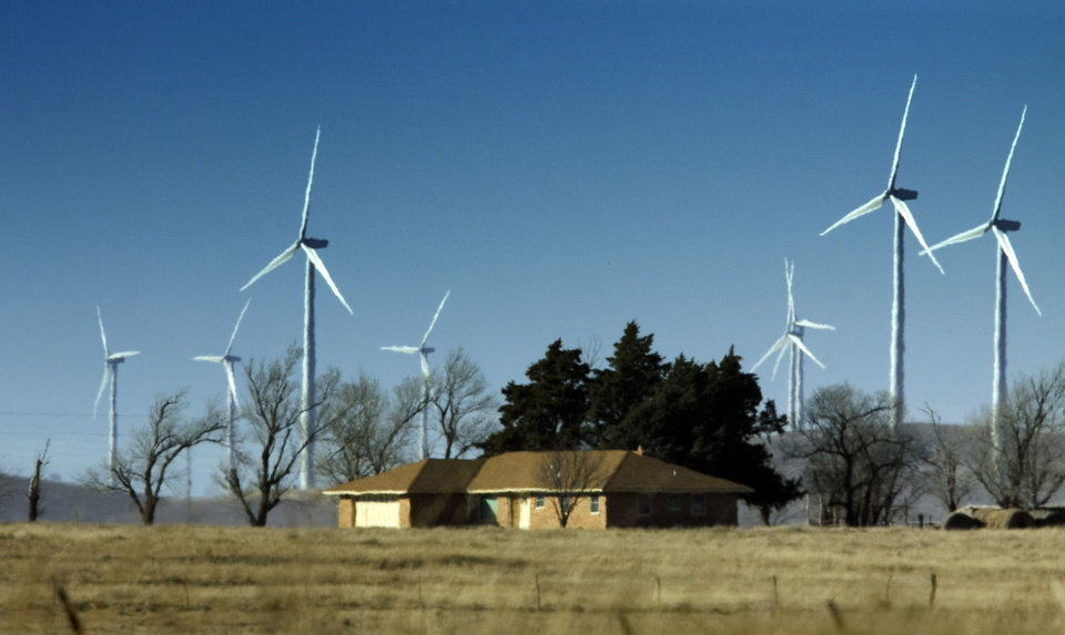 Photo - In this file photok, wind farm electrical power generators are seen near Mears Porter Hill Road west of US 62 and 277 in Elgin, Okla.   Photo by Steve Sisney, The Oklahoman Archives  STEVE SISNEY