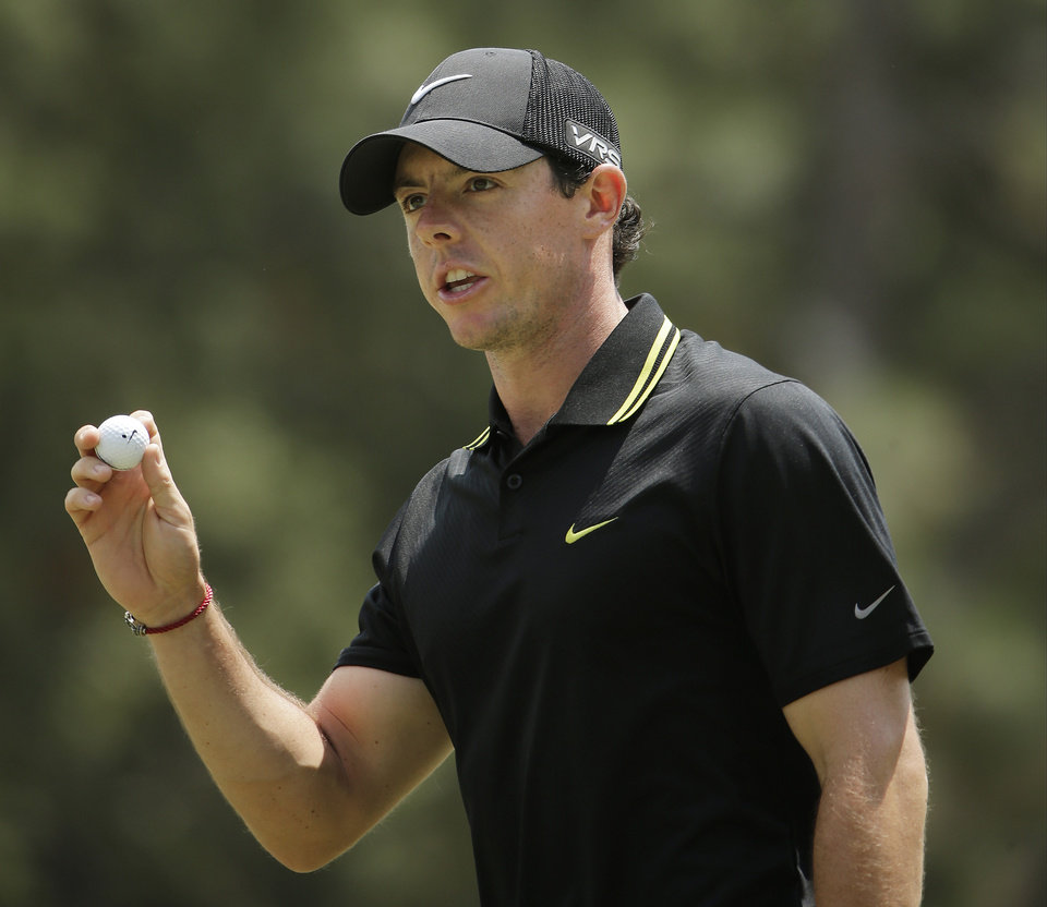 Photo - Rory McIlroy, of Northern Ireland, waves of the on the first green during the third round of the U.S. Open golf tournament in Pinehurst, N.C., Saturday, June 14, 2014. (AP Photo/Chuck Burton)
