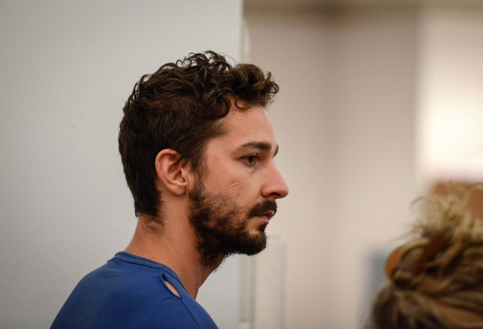 Photo - Shia LaBeouf, represented by a Legal Aid attorney, is arraigned in Midtown Community Court, in New York, Friday, June 27, 2014. LaBeouf was released from police custody Friday after he was escorted from a Broadway theater for yelling obscenities and continued to act irrationally while being arrested, authorities said. He's due back in court July 24. (AP Photo/Daily News, Anthony DelMundo, Pool)