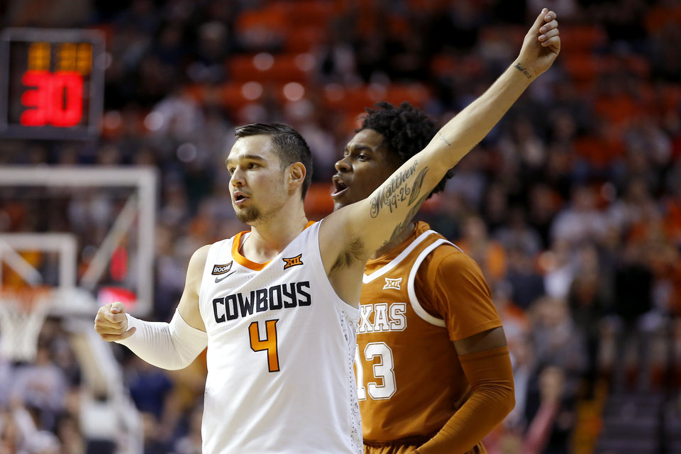 Photo - Oklahoma State's Thomas Dziagwa (4) celebrates after a basket in front of Texas' Jase Febres (13) during an NCAA basketball game between the Oklahoma State University Cowboys (OSU) and the Texas Longhorns at Gallagher-Iba Arena in Stillwater, Okla., Wednesday, Jan. 15, 2020. [Bryan Terry/The Oklahoman]