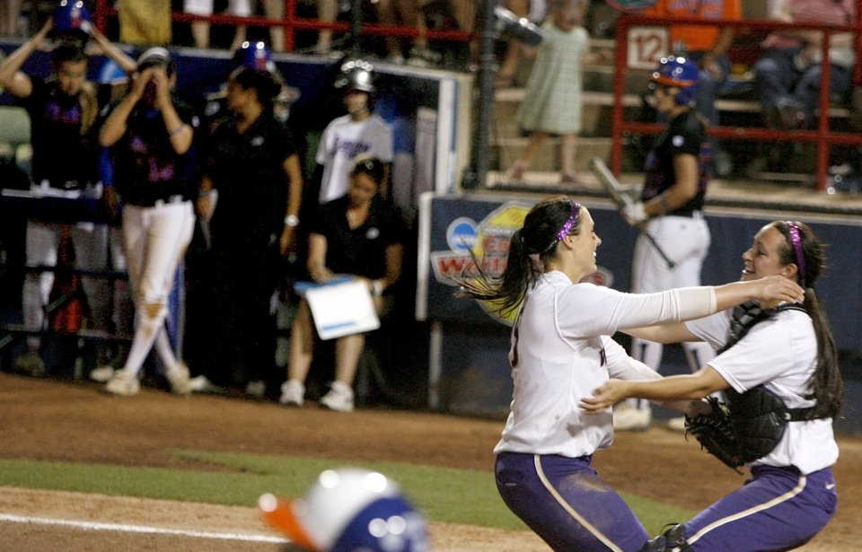 Photo - Washington's Danielle Lawrie, left, and Alicia Blake celebrate in front of Florida after Washington's 3-2 win in the second softball game of the championship series between Washington and Florida in Women's College World Series at ASA Hall of Fame Stadium in Oklahoma City, Tuesday, June 2, 2009. Photo by Bryan Terry, The Oklahoman