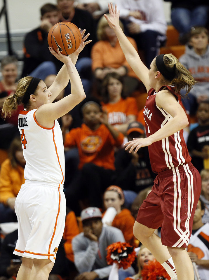 Photo - Oklahoma State's Liz Donohoe (4) shoots against Oklahoma's Nicole Kornet (1) during the Bedlam women's college basketball game between Oklahoma State University and the University of Oklahoma at Gallagher-Iba Arena in Stillwater, Okla., Saturday, Feb. 23, 2013. OSU beat OU, 83-62. Photo by Nate Billings, The Oklahoman