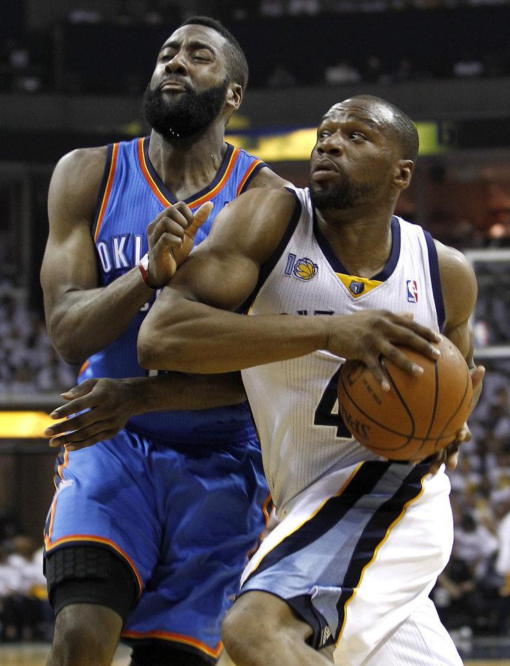 Photo - Memphis Grizzlies guard Sam Young (4) drives against Oklahoma City Thunder guard James Harden, left, during the first half of Game 6 of a second-round NBA basketball playoff series on Friday, May 13, 2011, in Memphis, Tenn. (AP Photo/Wade Payne)