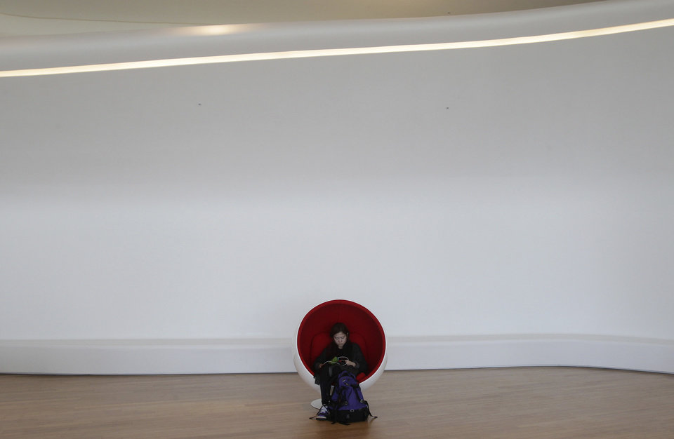 Photo - A visitor takes a rest at Dongdaemun Design Plaza in Seoul, South Korea, Friday, March 21, 2014. The $450 million building funded by Seoul citizen's tax money finally opened to public on Friday after years of debates about transforming a historic area with an ultra-modern architecture. (AP Photo/Ahn Young-joon)