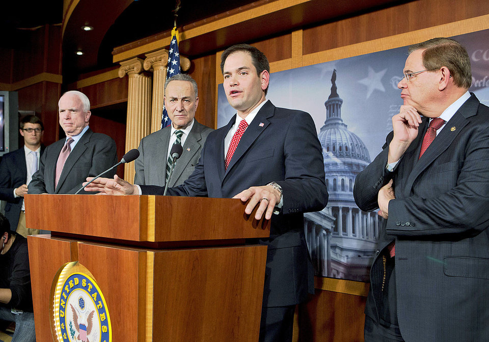 A bipartisan group of leading senators announces Monday that it has reached agreement on the principles of sweeping legislation to rewrite the nation's immigration laws during a news conference at the Capitol in Washington. From left are Sen. John McCain, R-Ariz., Sen. Charles Schumer, D-N.Y., Sen. Marco Rubio, R-Fla., and Sen. Robert Menendez, D-N.J.  AP PHOTO