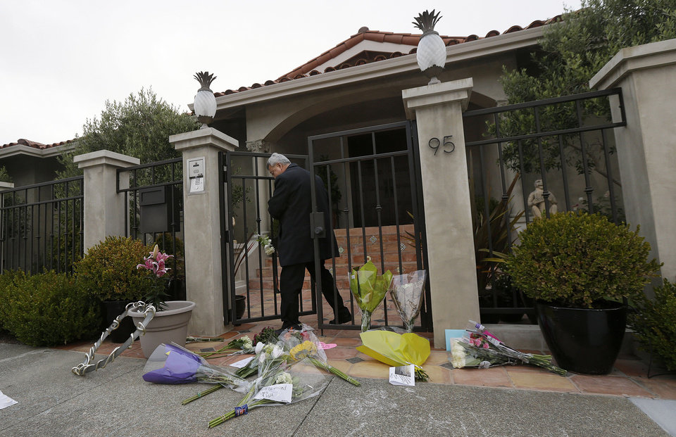 Photo - A man who did not give his name exits the front gate outside of the home of Robin Williams in Tiburon, Calif., Tuesday, Aug. 12, 2014. Williams died Monday in an apparent suicide at his San Francisco Bay Area home, according to the sheriff's office in Marin County, north of San Francisco. (AP Photo/Jeff Chiu)