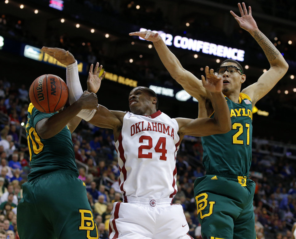 Photo - Oklahoma's Buddy Hield (24) loses control of the ball between Baylor's Royce O'Neale (00) and Isaiah Austin (21) during the Big 12 Tournament college basketball game between the University of Oklahoma and Baylor at the Sprint Center in Kansas City, Mo., Thursday, March 13, 2014. Baylor won 78-73.  Photo by Bryan Terry, The Oklahoman