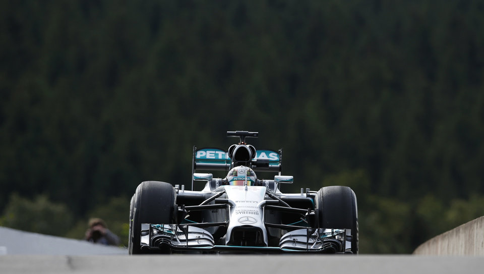 Photo - Mercedes driver Lewis Hamilton of Britain steers his car during the first free practice at the Spa-Francorchamps circuit, Belgium, Friday, Aug. 22, 2014. The Belgium Formula One Grand Prix will be held on Sunday. (AP Photo/Luca Bruno)