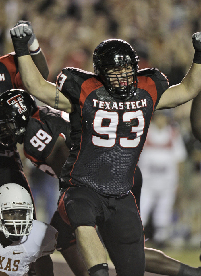 Photo - Texas Tech nose tackle Colby Whitlock (93) celebrates stopping Texas running back Chris Ogbonnaya, lower left, for a safety during the first half of an NCAA college football game in Lubbock, Texas, Saturday, Nov. 1, 2008. (AP Photo/LM Otero)  ORG XMIT: TXMO107