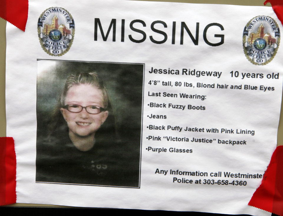 Photo -   A missing poster is taped to a post near the home of the missing 10-year-old Jessica Ridgeway in Westminster, Colo., on Friday, Oct. 12, 2012. Police discovered a body in a field six miles away but have yet to identify the remains. Jessica Ridgeway went missing on Friday, Oct. 5 after she left her home on her way to school. (AP Photo/Ed Andrieski)