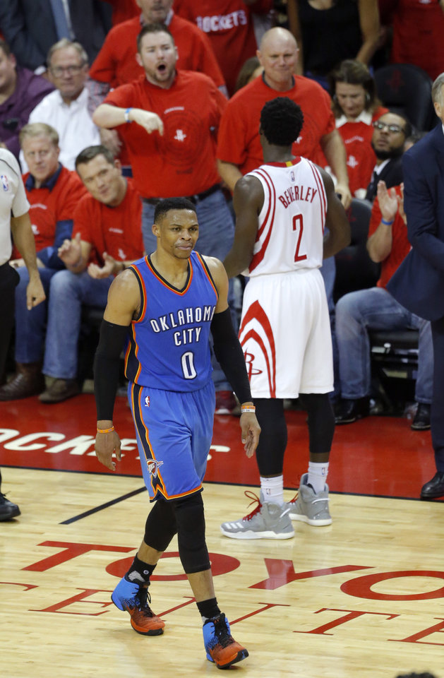Photo - Oklahoma City's Russell Westbrook (0) reacts after fouling Houston's Patrick Beverley (2) during Game 5 in the first round of the NBA playoffs between the Oklahoma City Thunder and the Houston Rockets in Houston, Texas,  Tuesday, April 25, 2017.  Photo by Sarah Phipps, The Oklahoman
