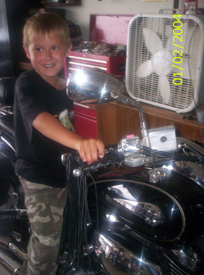 Kash on uncle Bill motor cycle<br/><b>Community Photo By:</b> tama<br/><b>Submitted By:</b> Tama, Midwest