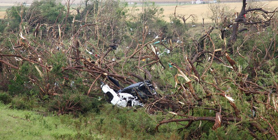 Photo - Two car are destroyed after being swept off I-40 west of El Reno by a tornado on  Tuesday, May 24, 2011. Photo by Chris Landsberger, The Oklahoman ORG XMIT: KOD