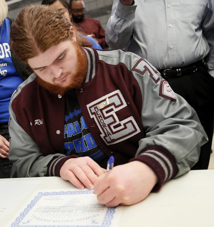 Photo - Jordan Weltzheimer signs to play football with Air Force during the college signing day ceremony for student athletes at Edmond Memorial High School in Edmond, Okla., Wednesday, Feb. 5, 2014. Photo by Nate Billings, The Oklahoman