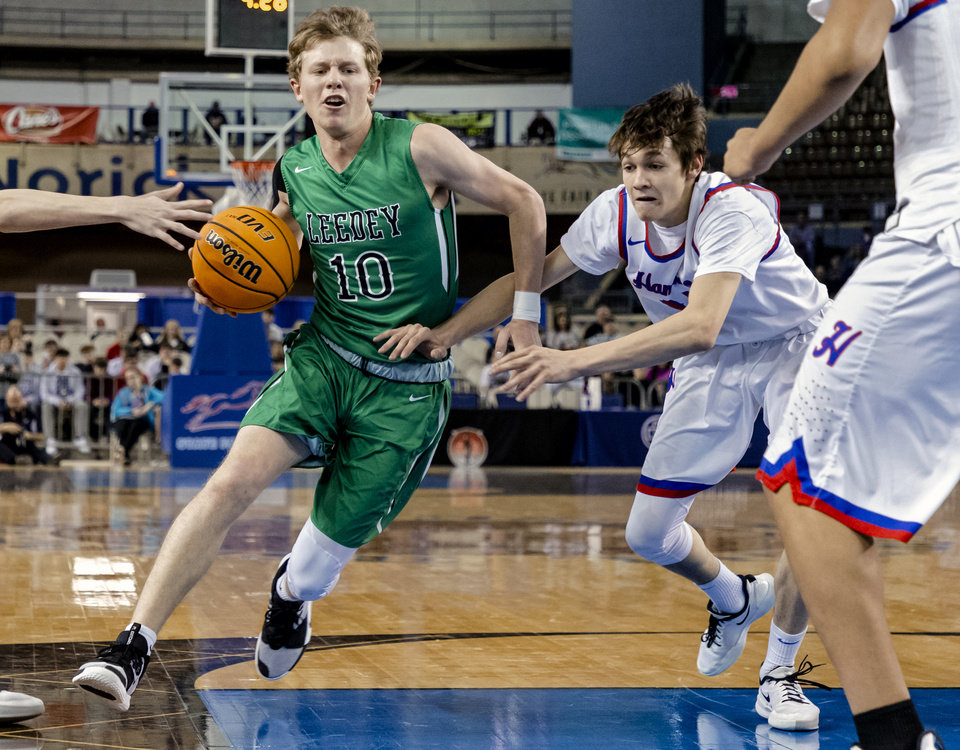 Photo - Leedey's Ty Goss (10) drives the ball past Hammon's Peyton Osmond (10) during a Class B boys state tournament semi-final basketball game between Hammon vs Leedey in the Jim Norick Arena at State Fair Park in Oklahoma City, Okla. on Friday, March 6, 2020.  [Chris Landsberger/The Oklahoman]