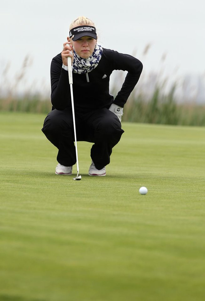 Photo - Jessica Korda lines up a putt on the second hole during a pro-am for the Shoprite Classic golf tournament in Galloway, N.J., , Thursday, May 29, 2013. (AP Photo/The Press of Atlantic City, Michael Ein) MANDATORY CREDIT