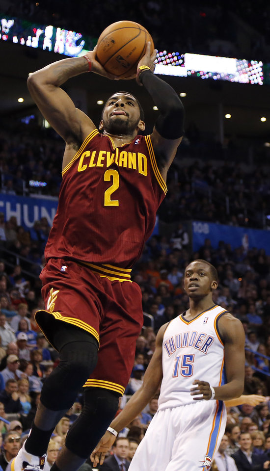 Photo - Cleveland's Kyrie Irving (2) drives past Oklahoma City's Reggie Jackson (15) for a shot during the NBA basketball game between the Oklahoma City Thunder and the Cleveland Cavaliers at the Chesapeake Energy Arena in Oklahoma City, Okla. on Wednesday, Feb. 26, 2014.  Photo by Chris Landsberger, The Oklahoman