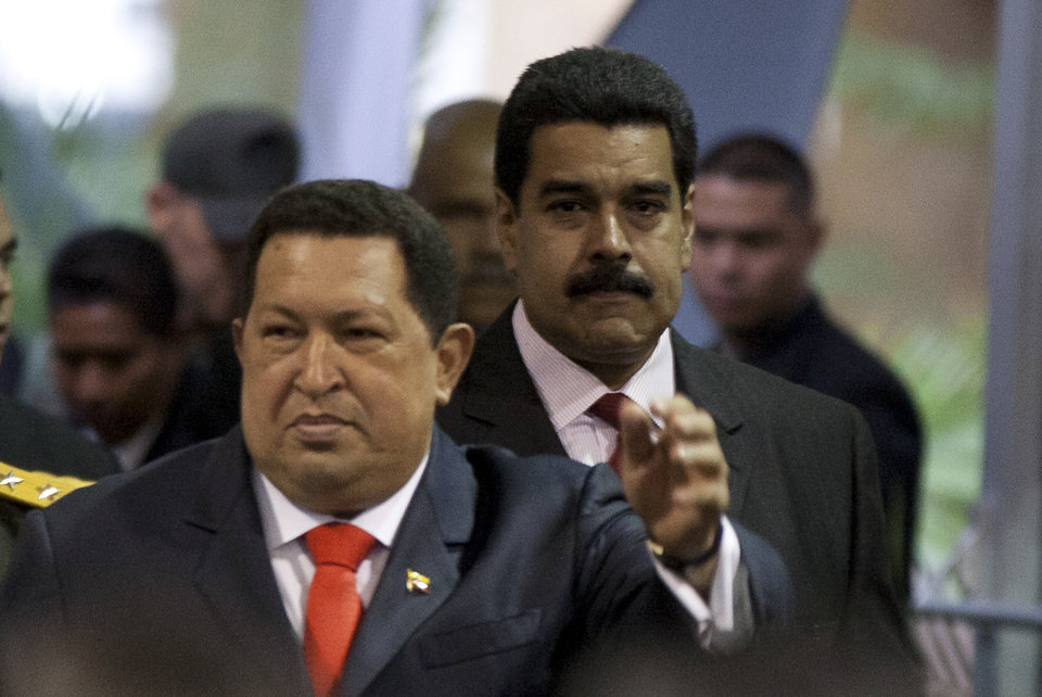 Foreign Minister Nicolas Maduro, right, follows Venezuela's President Hugo Chavez as they arrive to a ceremony declaring Chavez winner of Sunday's presidential elections at the Electoral Council in Caracas, Venezuela, Wednesday, Oct. 10, 2012. During the event Chavez announced a new vice president, choosing his longtime foreign minister Nicolas Maduro. (AP Photo/Ariana Cubillos)