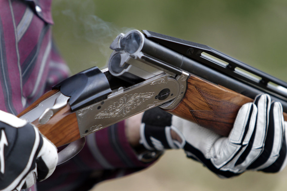 Photo - A participant reloads his shotgun during the Oklahoma Sporting Clays State Championships being held at Quail Ridge Sporting Clays on Friday, June 1, 2012, in Oklahoma City, Okla.  Photo by Steve Sisney, The Oklahoman