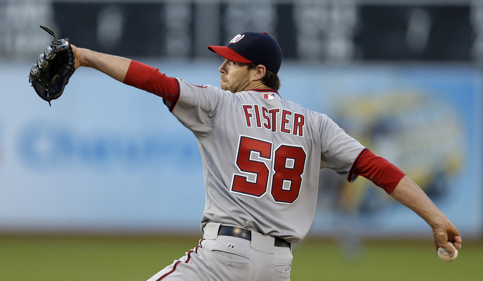 Photo - Washington Nationals' Doug Fister works against the Oakland Athletics in the first inning of a baseball game on Friday, May 9, 2014, in Oakland, Calif. (AP Photo/Ben Margot)