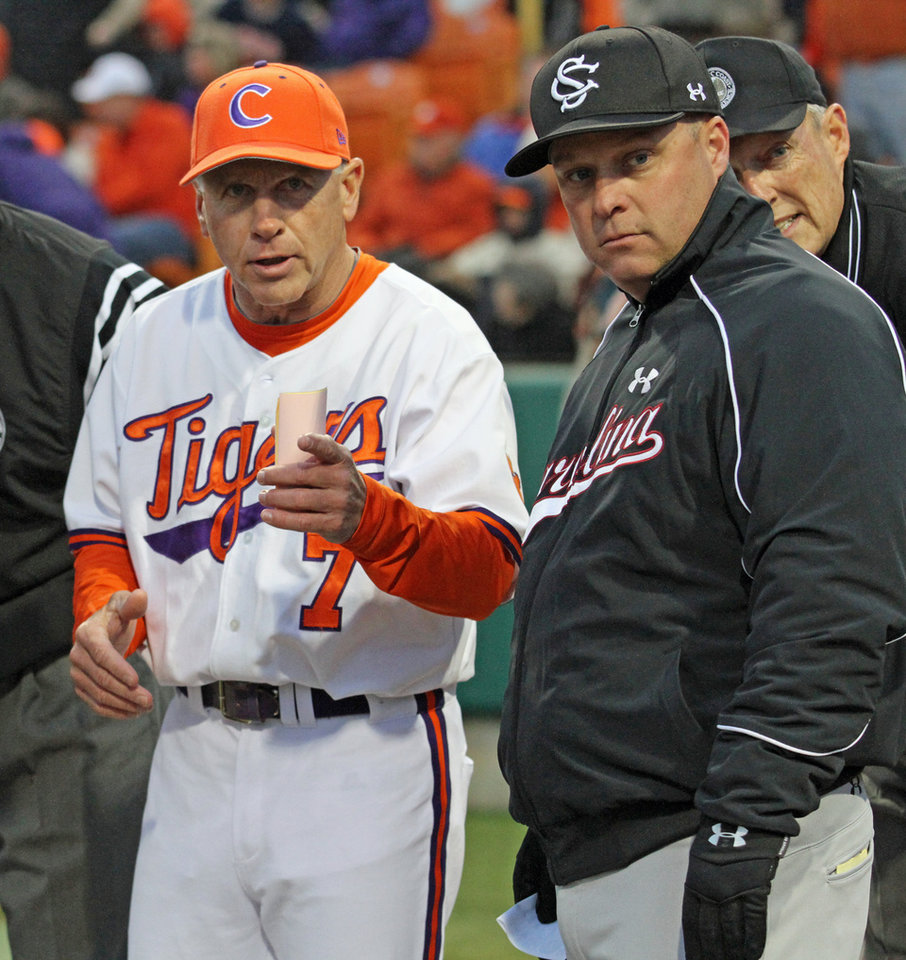 Clemson head coach Jack Leggett, left, goes over the ground rules with South Carolina head coach Chad Holbrook before their NCAA college baseball game at Doug Kingsmore Stadium, Friday, March 1, 2013, in Clemson, S.C. (AP Photo/Anderson Independent-Mail, Mark Crammer)  GREENVILLE NEWS OUT, SENECA NEWS OUT