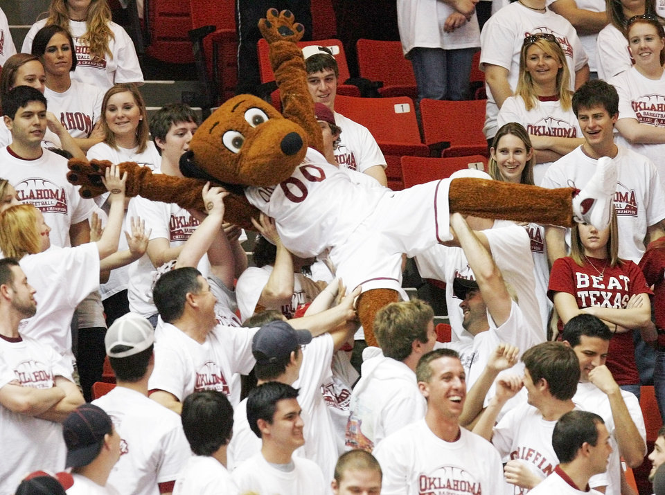 Photo - OU mascot Top Daug crowd surfs in the second half during the men's college basketball game between University of Oklahoma and Texas A&M University at the Lloyd Noble Center in Norman, Okla., Saturday, March 1, 2008. Ken Evans returned to perform as Top Daug as part of a tribute to the 1988 OU men's basketball team. The Sooners won, 64-37. BY NATE BILLINGS, THE OKLAHOMAN