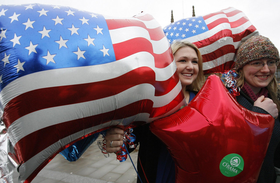 Photo - Jordan Junge, left, from Denver and Jamie Ferguson from Alabama, USA,  both Queen's University students in Belfast,  arrive at the university to watch on TV the inauguration of Barack Obama as President, in Belfast, Northern Ireland, Tuesday, Jan, 20, 2009.  (AP Photo / Peter Morrison)