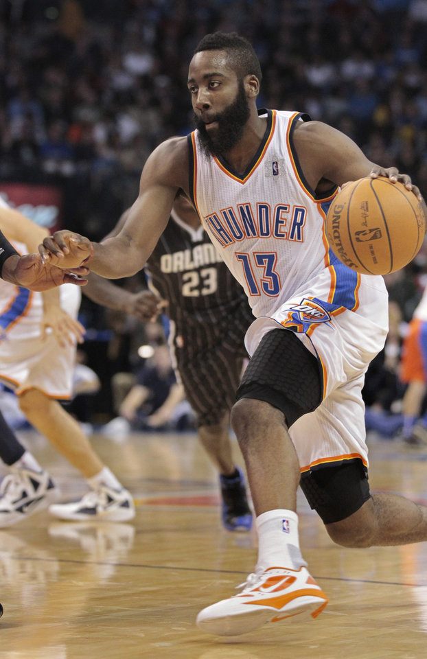 Oklahoma City Thunder's James Harden (13) drives to the basket in the second half as the Oklahoma City Thunder defeat the Orlando Magic 97-89 in NBA basketball at the Chesapeake Energy Arena on Sunday, Dec. 25, 2011, in Oklahoma City, Okla.  Photo by Steve Sisney, The Oklahoman