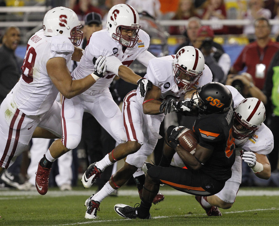 From left; Stanford defensive end Matthew Masifilo, safety Myles Muagututia and defensive tackle Jacob Gowan stop Oklahoma State wide receiver Isaiah Anderson during the first half of the Fiesta Bowl NCAA college football game Monday, Jan. 2, 2012, in Glendale, Ariz. (AP Photo/Ross D. Franklin)