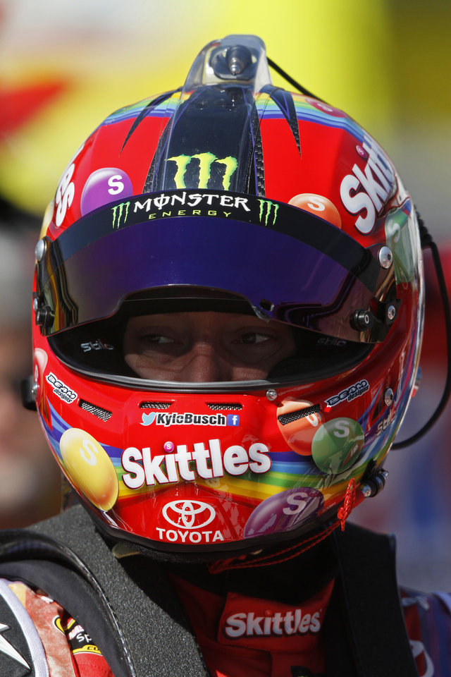 Photo - Driver Kyle Busch (18) waits during practice for the NASCAR Sprint Cup series auto race at Bristol Motor Speedway on Friday, March 14, 2014, in Bristol, Tenn. (AP Photo/Wade Payne)
