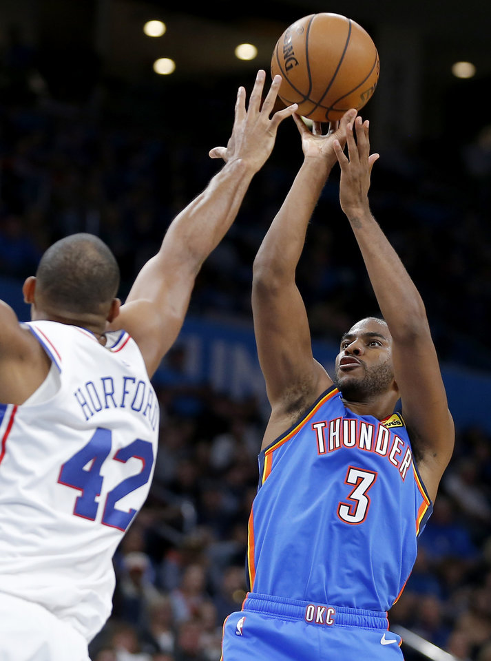 Photo - Oklahoma City's Chris Paul (3) shoots over Philadelphia's Al Horford (42) during an NBA basketball game between the Oklahoma City Thunder and the Philadelphia 76ers at Chesapeake Arena in Oklahoma City, Friday, Nov. 15, 2019. Oklahoma City won 127-119. [Bryan Terry/The Oklahoman]