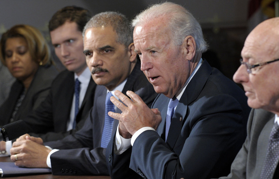 Photo - Vice President Joe Biden, with Attorney General Eric Holder at left, speaks during a meeting with victim's groups and gun safety organizations in the Eisenhower Executive Office Building on the White House complex in Washington, Wednesday, Jan. 9, 2013. Biden is holding a series of meetings this week as part of the effort he is leading to develop policy proposals in response to the Newtown, Conn., school shooting (AP Photo/Susan Walsh)