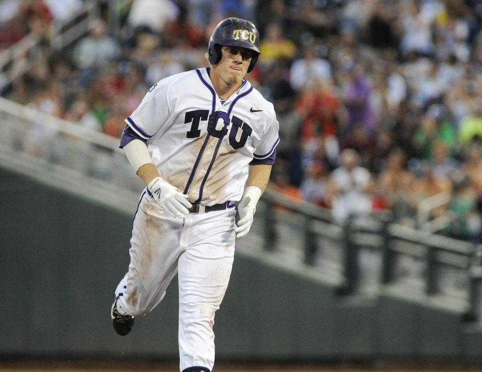 Photo - TCU's Kevin Cron rounds the bases after hitting a solo home run against Mississippi in the fifth inning of an NCAA baseball College World Series elimination game in Omaha, Neb., Thursday, June 19, 2014. (AP Photo/Eric Francis)