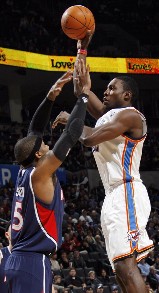Oklahoma City's Jeff Green (22) shoots over Josh Smith (5) of Atlanta during the NBA basketball game between the Atlanta Hawks and the Oklahoma City Thunder at the Ford Center in Oklahoma City, Tuesday, February 2, 2010. The Thunder won, 106-99. Photo by Nate Billings, The Oklahoman