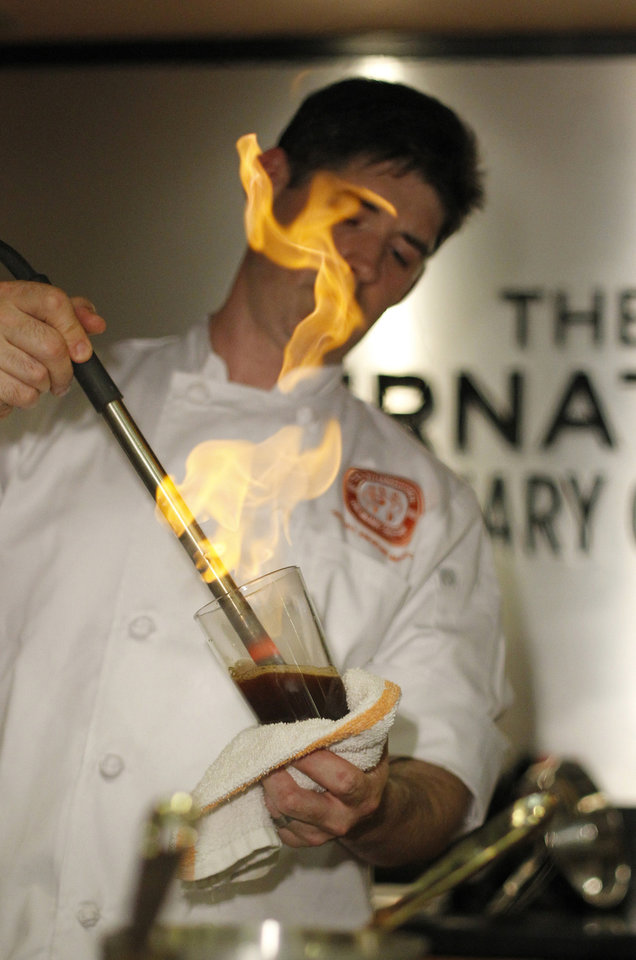 Photo - Renowned New York chef and mixologist Dave Arnold inserts hot pokers into the