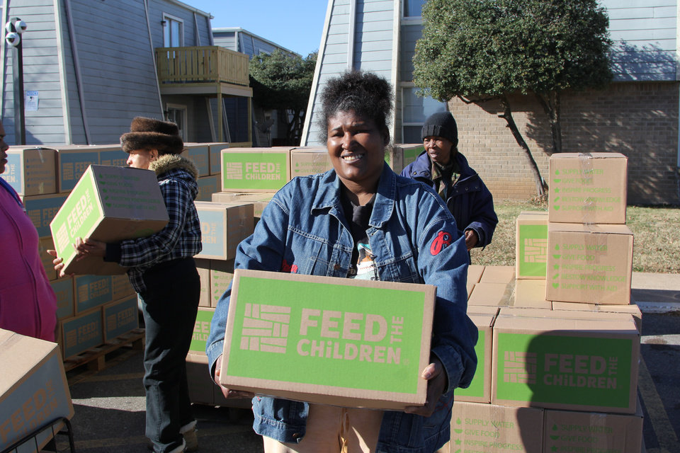 Photo - Oklahoma City resident Tanya Dixon and many other families in Northwest Oklahoma City received food and essentials from Feed the Children last Saturday. Photo by Michaela Marx Wheatley