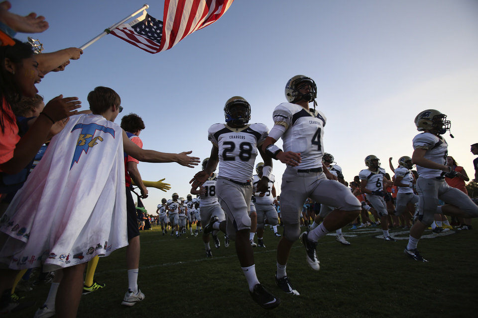 Heritage Hall takes the field at Casady High School in The Village, Okla., Thursday, Aug. 30, 2012.  Photo by Garett Fisbeck, The Oklahoman