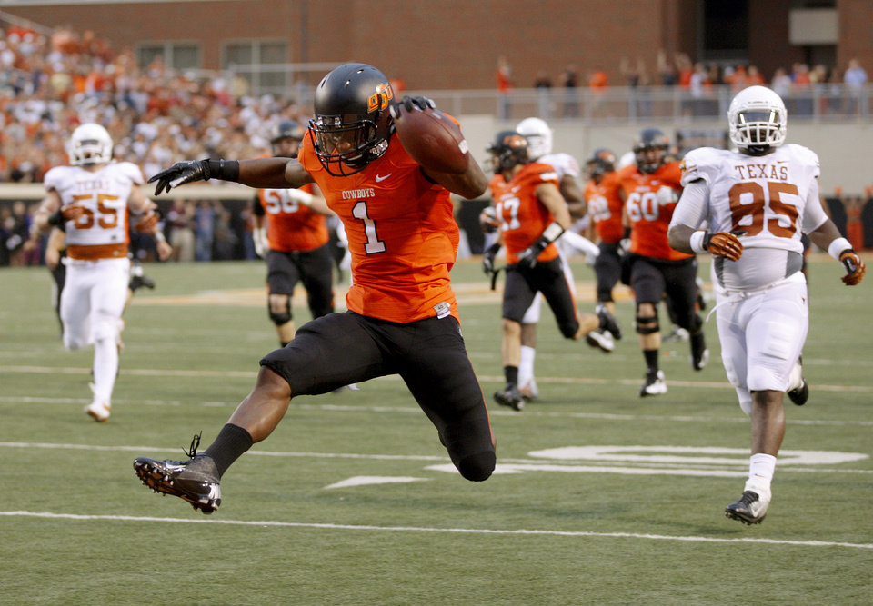 Photo - Oklahoma State's Joseph Randle (1) scores a touchdown during a college football game between Oklahoma State University (OSU) and the University of Texas (UT) at Boone Pickens Stadium in Stillwater, Okla., Saturday, Sept. 29, 2012. Photo by Bryan Terry, The Oklahoman