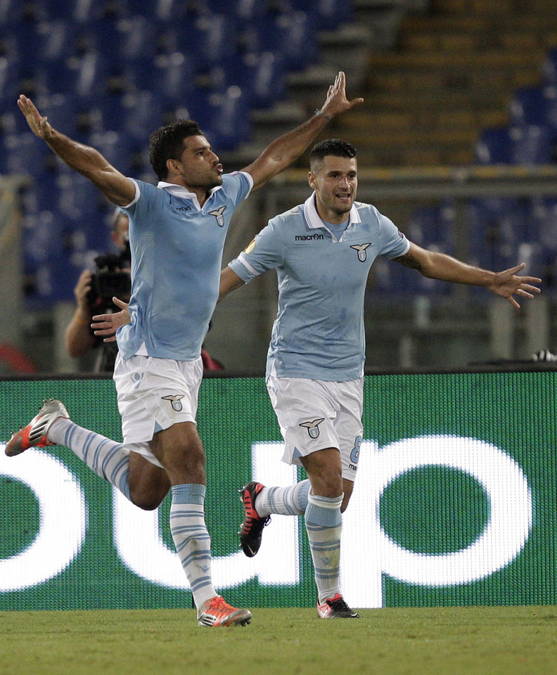 Photo -   Lazio midfielder Ederson, of Brazil, left. celebrates with teammate Antonio Candreva after scoring during the Europa League Group J soccer match between Lazio and Maribor, at the Rome Olympic stadium Thursday, Oct. 4, 2012. (AP Photo/Riccardo De Luca)
