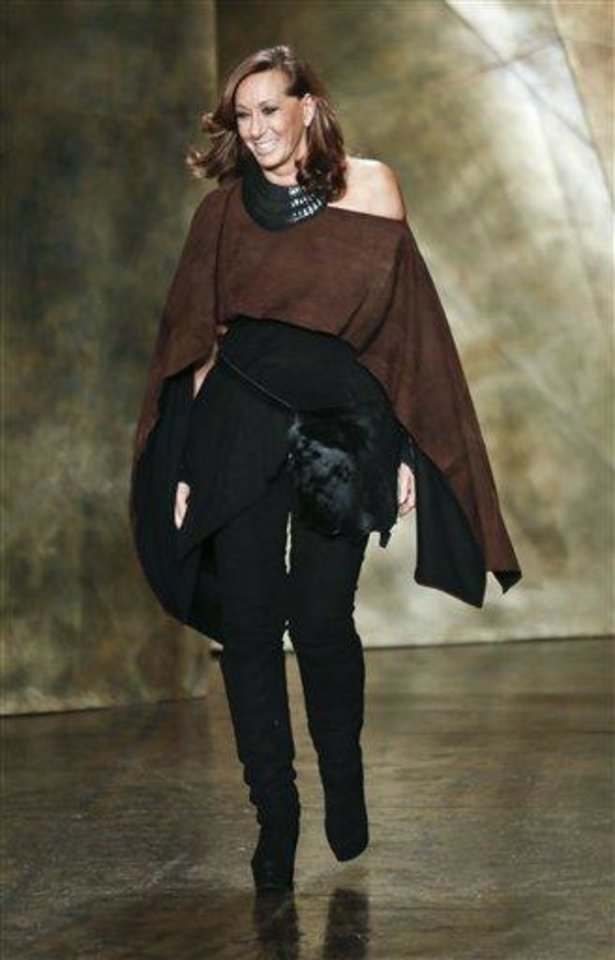 Fashion designer Donna Karan New York appears on the runway after  showing her Fall 2013 collection on Monday, Feb. 11, 2013 in New York.  (AP Photo/Bebeto Matthews)