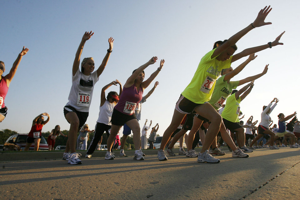 Runners participate in a group stretching exercise before beginning the 22nd annual Renaissance Run in Midwest City, OK, Saturday, Sept. 27, 2008. BY PAUL HELLSTERN, THE OKLAHOMAN